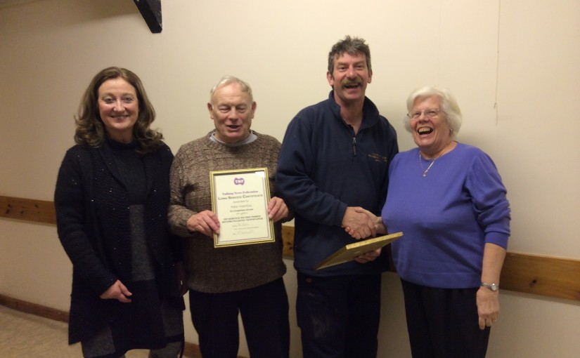 Photogrph of Peter and Pam Martin Receiving Certificates.