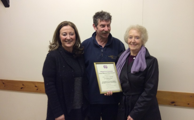 Photograph of Rita Clarke receiving certificate.